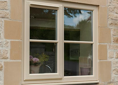 Cream uPVC stormproof casement window