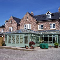 Chartwell green colour timber conservatory