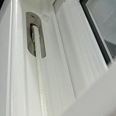 Timber sliding sash window with weights and pulleys lift mechanism