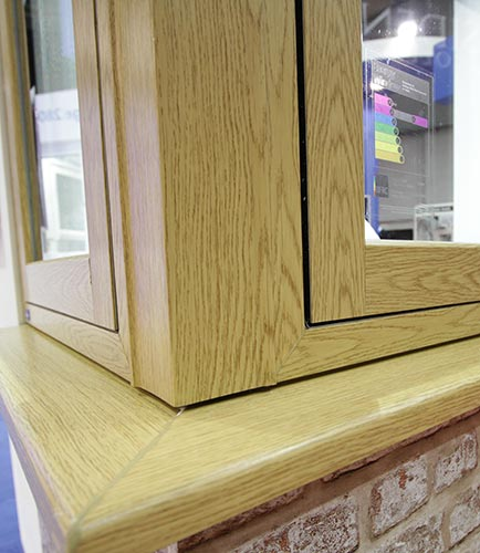 Flush sash window with woodgrain foil finish
